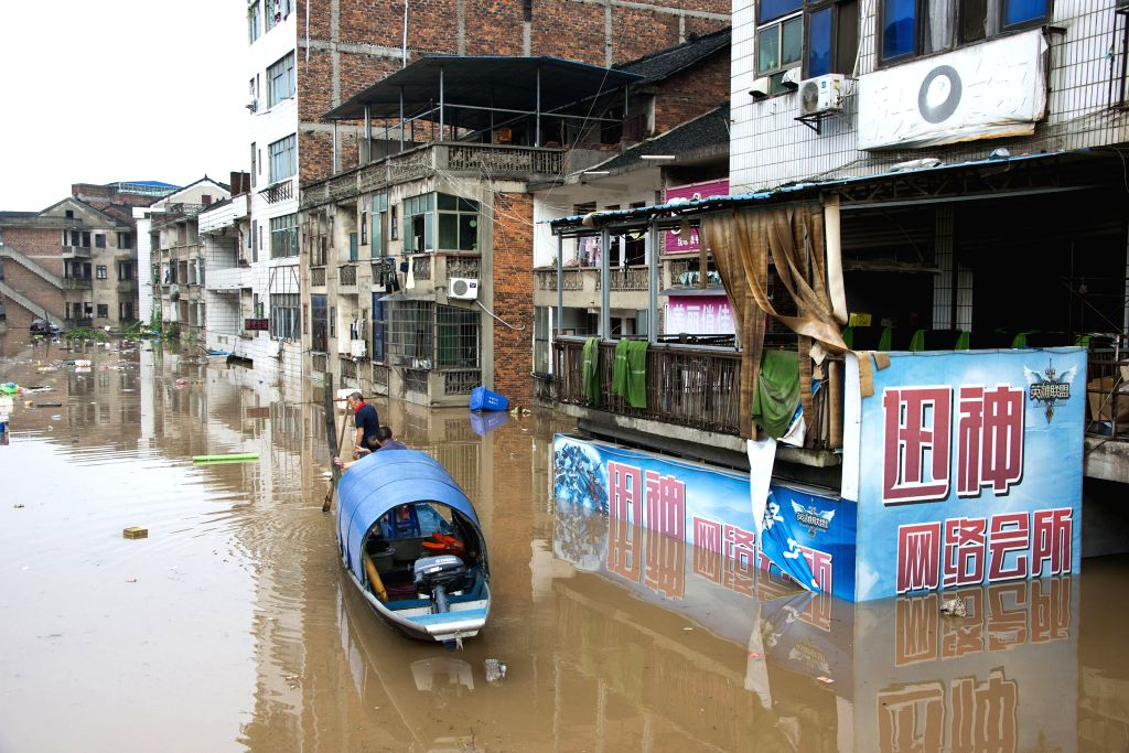 SHAOYANG, July 2, 2017 - A boat patrols to rescue stranded people on a street of Xinshao County, Shaoyang City of central China's Hunan Province, July 2, 2017. Recently Shaoyang witnessed the ...