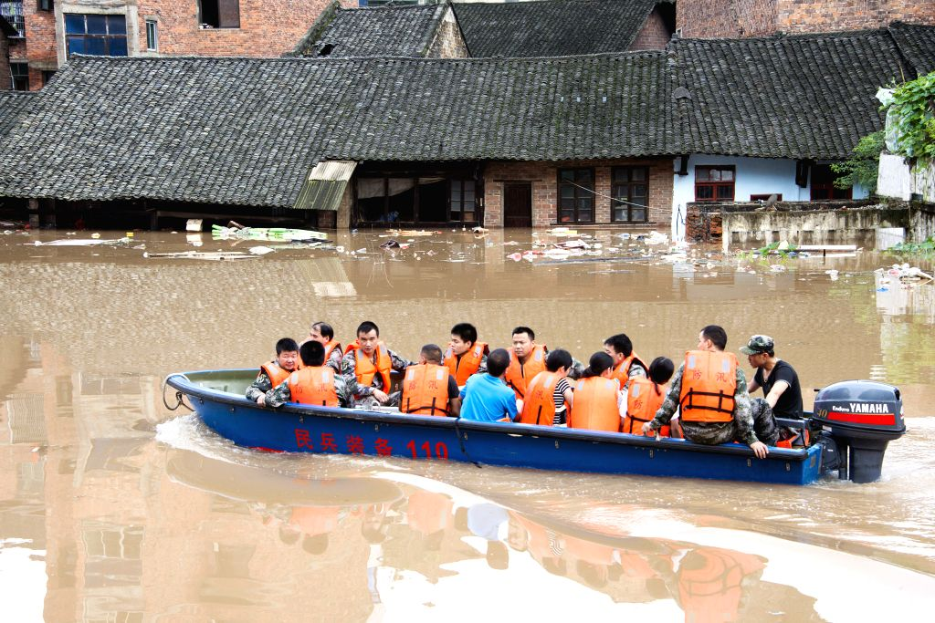 SHAOYANG, July 2, 2017 - Soldiers relocate stranded people in Xinshao County, Shaoyang City of central China's Hunan Province, July 2, 2017. Recently Shaoyang witnessed the heaviest flood this year.
