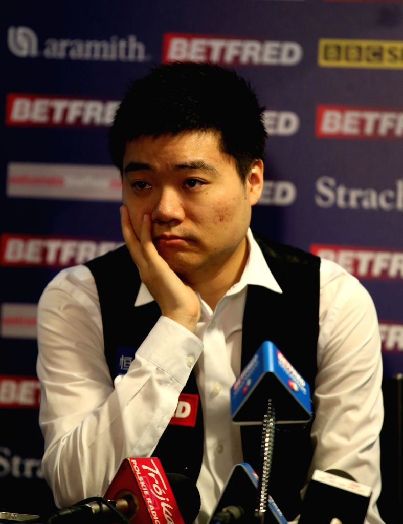 Ding Junhui of China gestures during a press conference after the third session of the quarterfinal against Judd Trump of England at the 2015 World Snooker ...