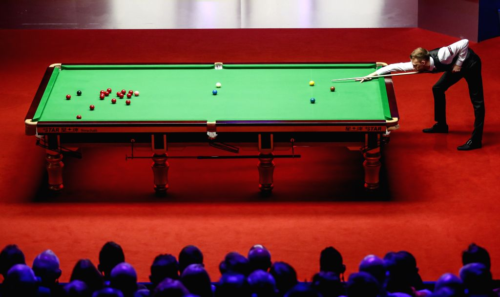 SHEFFIELD, May 6, 2019 - England's Judd Trump competes during the third session of final with Scotland's John Higgins at World Snooker Championship 2019 in Sheffield, Britain on May 6, 2019.