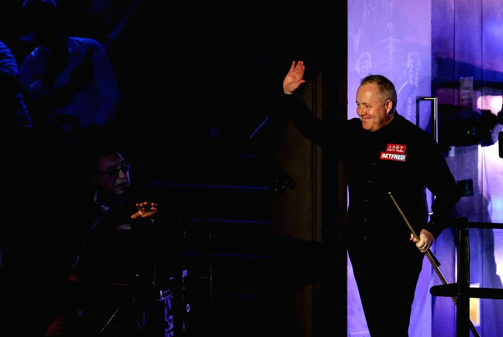SHEFFIELD, May 6, 2019 - Scotland's John Higgins enters the arena before the third session of final with England's Judd Trump at World Snooker Championship 2019 in Sheffield, Britain on May 6, 2019.