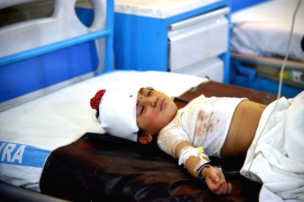 Sheikhupura (Pakistan), July 3, 2020 An injured girl is treated at a hospital in Sheikhupura, eastern Pakistan, on July 3, 2020. A train hit a passenger van at a railway crossing in ...