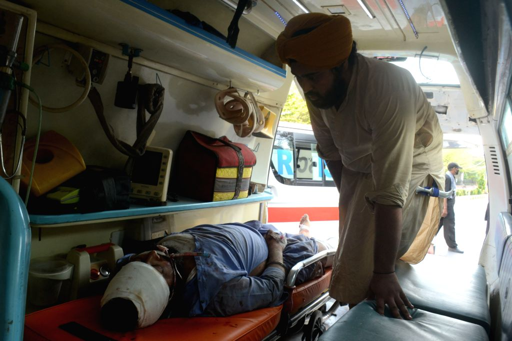 Sheikhupura (Pakistan), July 3, 2020 An injured man is seen at an ambulance outside a hospital in Sheikhupura, eastern Pakistan, on July 3, 2020. A train hit a passenger van at a railway ...