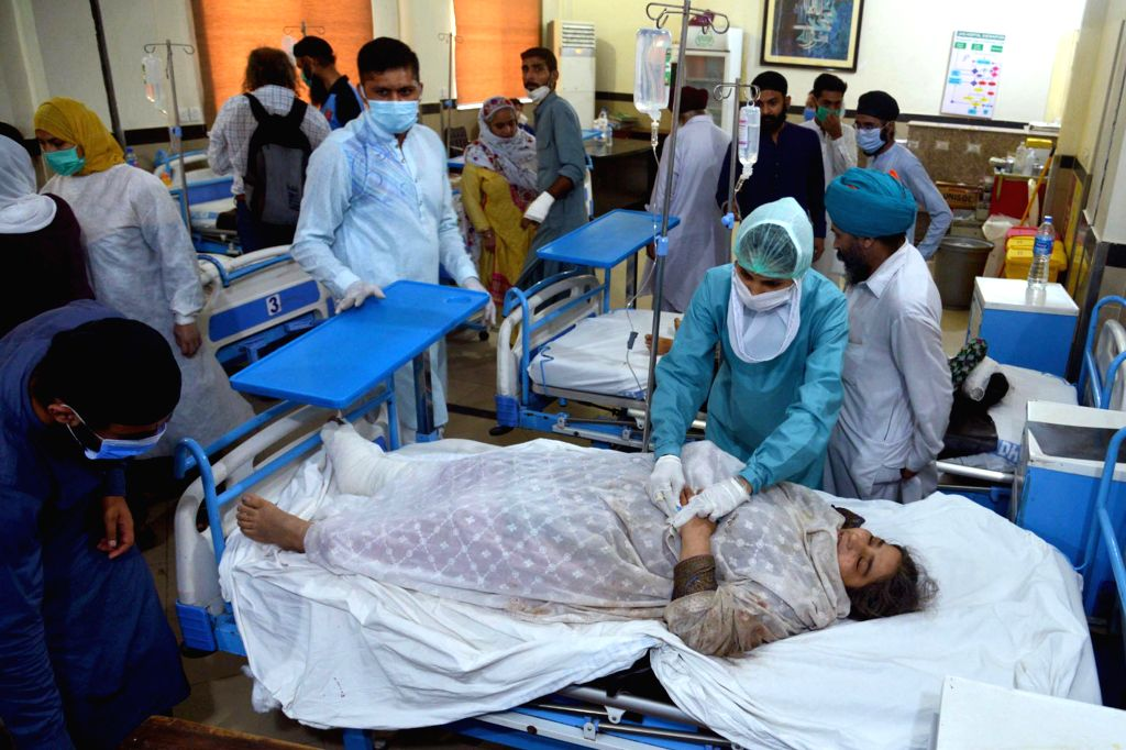Sheikhupura (Pakistan), July 3, 2020 An injured woman is treated at a hospital in Sheikhupura, eastern Pakistan, on July 3, 2020. A train hit a passenger van at a railway crossing in ...