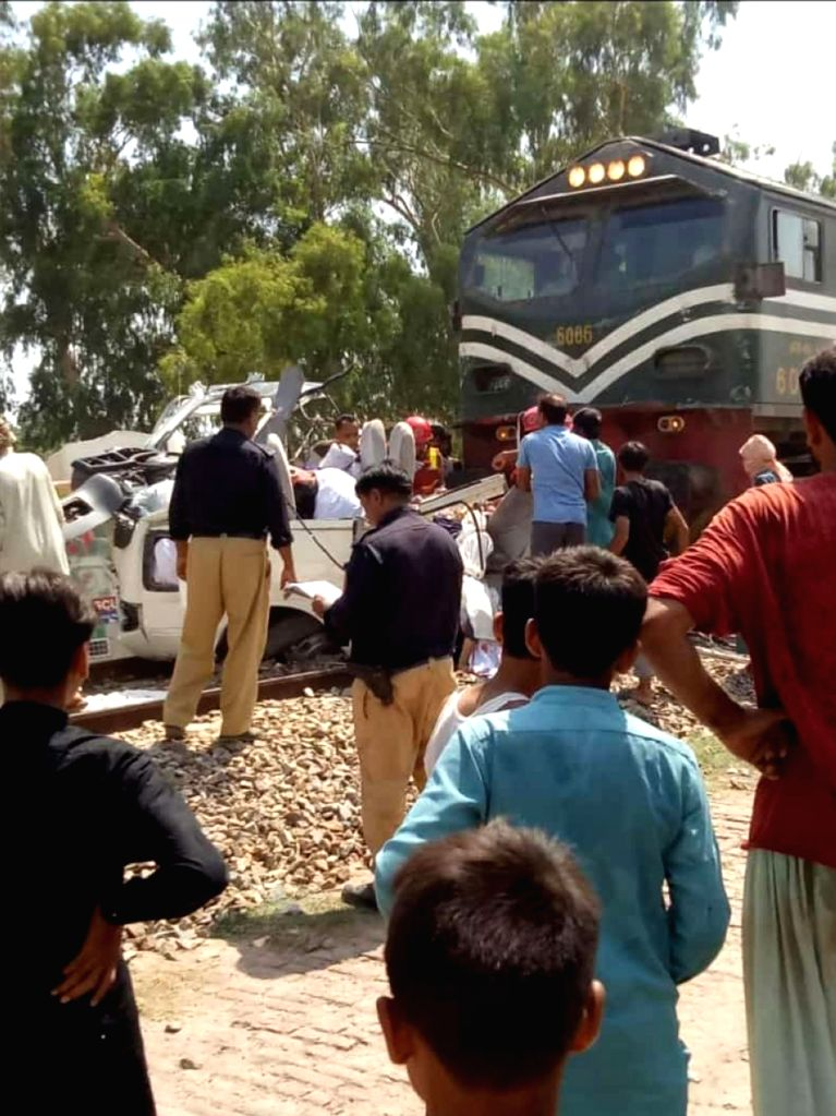 Sheikhupura (Pakistan), July 3, 2020 People gather at the site where a collision occurred in Sheikhupura, eastern Pakistan, on July 3, 2020. A train hit a passenger van at a railway ...