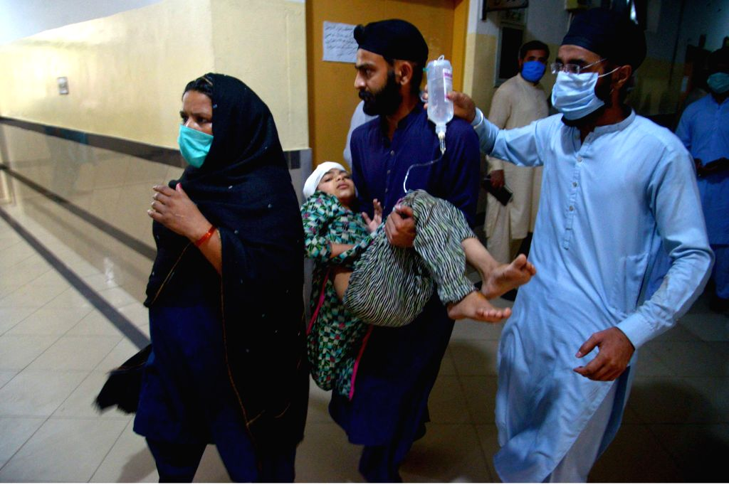 Sheikhupura (Pakistan), July 3, 2020 People transfer an injured girl at a hospital in Sheikhupura, eastern Pakistan, on July 3, 2020. A train hit a passenger van at a railway crossing in ...