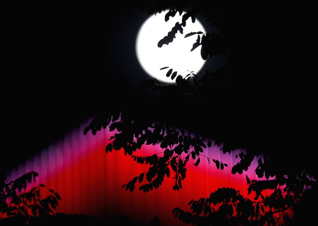 Photo taken on Sept. 8, 2014 shows the moon of the Mid-autumn Festival over the sky in Shenyang, capital of northeast China's Liaoning Province.   (Xinhua/Li ...