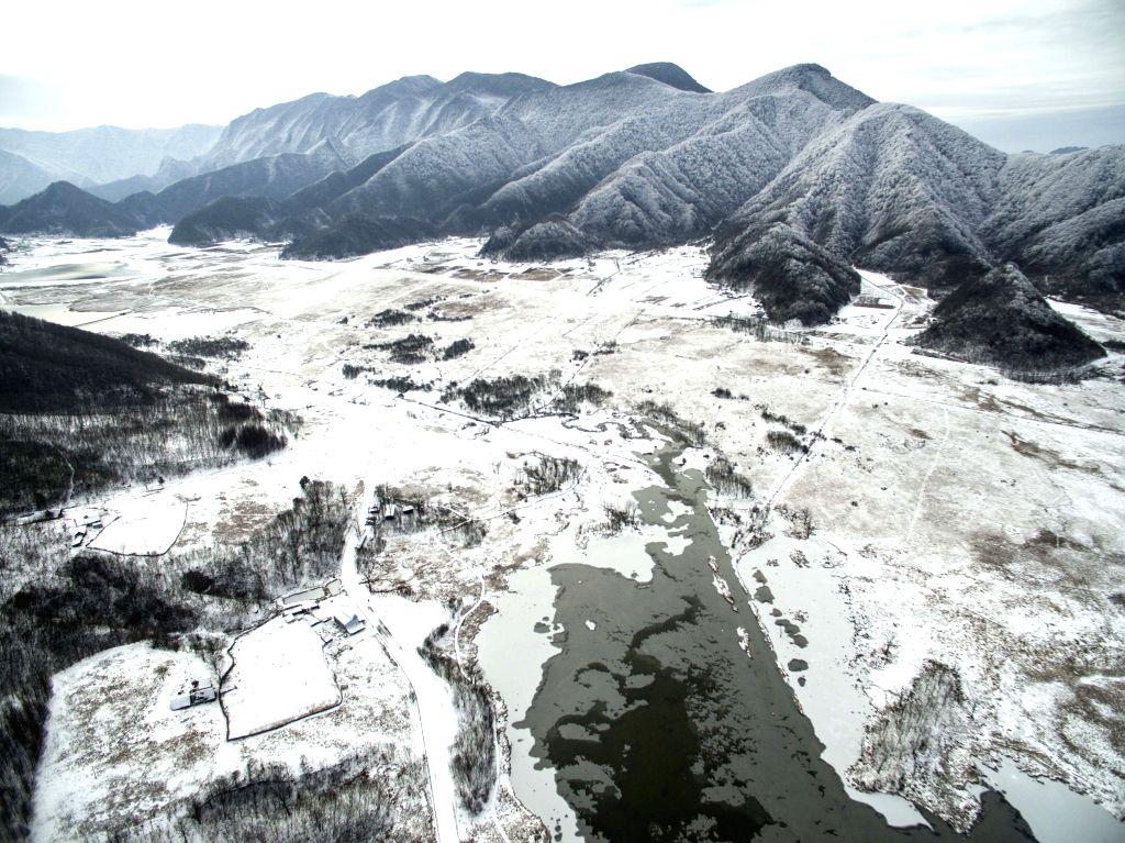 SHENNONGJIA, Jan. 13, 2017 - Aerial photo taken on Jan. 12, 2017 shows scenery of Dajiu Lake (nine lakes) national wetland park in Shennongjia, central China's Hubei Province. An environmental ...