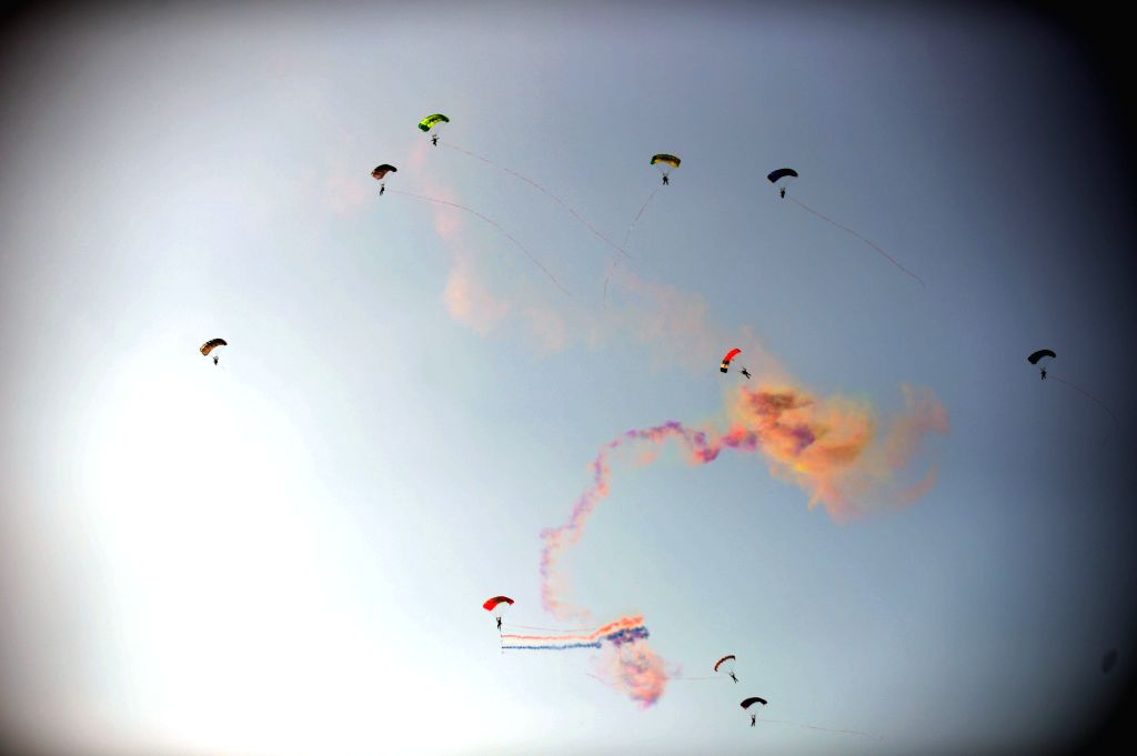A parachute performance is staged at the opening of the 2014 Shenyang Faku International Flight Convention, in Faku County of Shenyang, capital of northeast ...