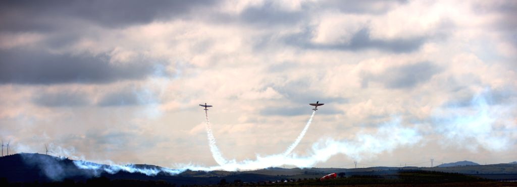 Members of the Twister aerobatics team do a stunt in their Silence SA1100s during a test flight for upcoming performances during the 2014 Shenyang Faku ...