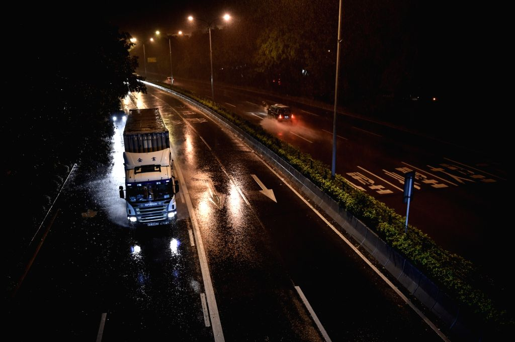 SHENZHEN, Aug 2, 2016 - A truck runs amid heavy rain on a road in Shenzhen, south China's Guangdong Province, Aug. 2, 2016. Typhoon Nida landed at 3:35 a.m. Tuesday at the Dapeng Peninsula in the ...