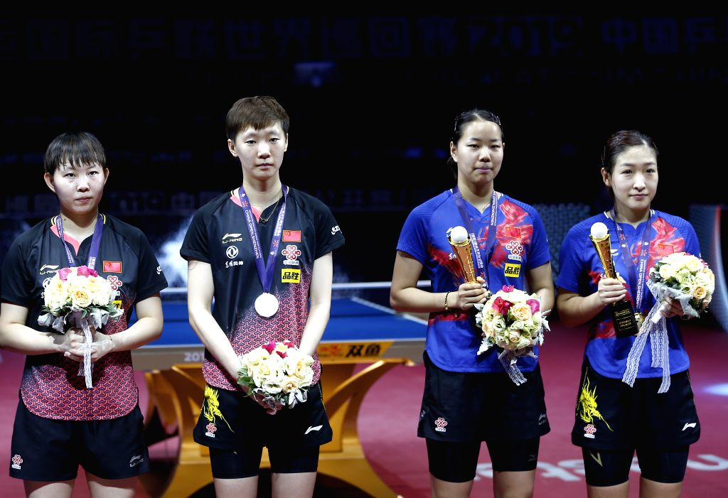 SHENZHEN, June 1, 2019 - Golde medalists Liu Shiwen (1st R)/Gu Yuting (2nd R) and silver medalists Wang Manyu (2nd L)/Zhu Yuling (1st L) pose for photos during the awarding ceremony after their ...