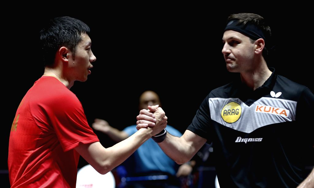 SHENZHEN, June 1, 2019 - Xu Xin (L) of China shakes hands with Timo Boll of Germany after their men's singles quarterfinal match at ITTF World Tour Platinum China Open in Shenzhen, south China's ...