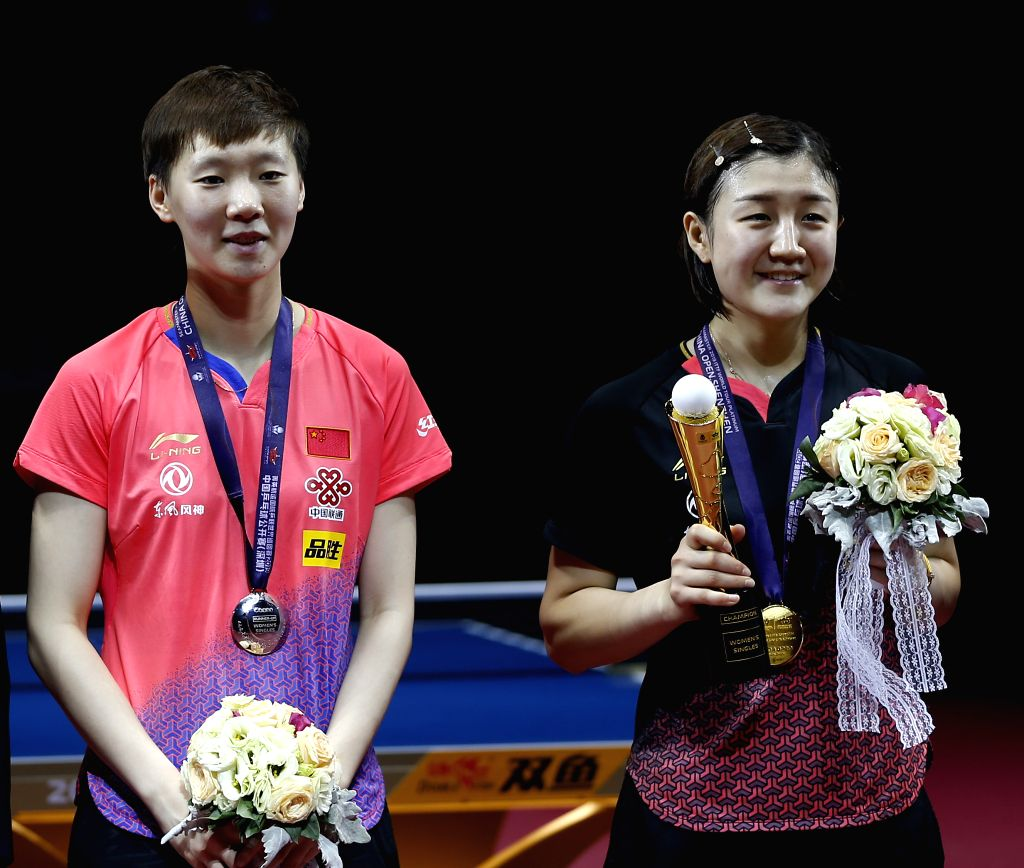 SHENZHEN, June 2, 2019 - Chen Meng (R) and Wang Manyu of China pose for photos during the awarding ceremony after the women's singles final match at ITTF World Tour Platinum China Open in Shenzhen, ...