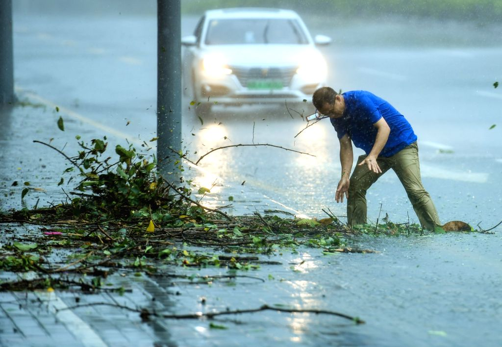 SHENZHEN, Sept. 16, 2018 - A staff member clears up blocked sewers on a road at Nanshan District in Shenzhen, south China's Guangdong Province, Sept. 16, 2018. According to China's National ...