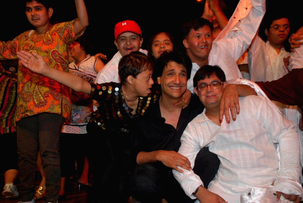 Shiamak Davar with mentally challenged children at Rang Birangi show, Organised by Parents of Downs Syndrome Association at St Andrews in Mumbai.