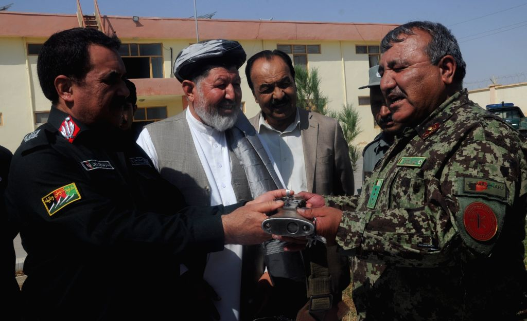 SHIBERGHAN(Afghanistan), Sept. 13, 2017 An Afghan local official receives a weapon in Shiberghan city of Jawzjan province, Afghanistan, Sept. 13, 2017. A huge quantity of arms and ...