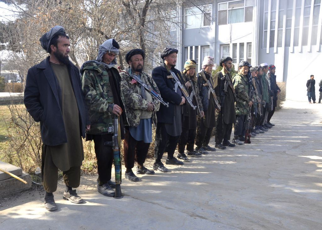 SHIBERGHAN, Feb. 12, 2018 - Anti-government militants attend a surrender ceremony in Shiberghan city, capital of Jawzjan province, Afghanistan, on Feb. 12, 2018. A total of 13 anti-government ...