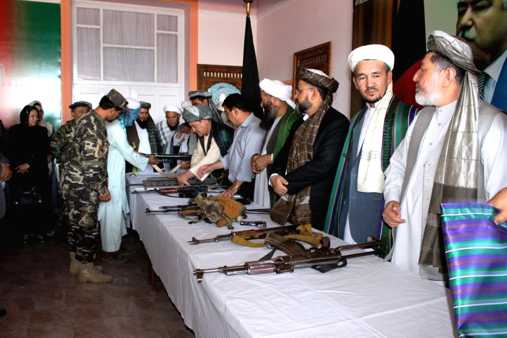 SHIBERGHAN, June 18, 2016 - Taliban militants attend a surrender ceremony in Sheberghan, capital of northern Jawzjan province, Afghanistan, June 18, 2016. Some 15 Taliban rebels surrendered to the ...