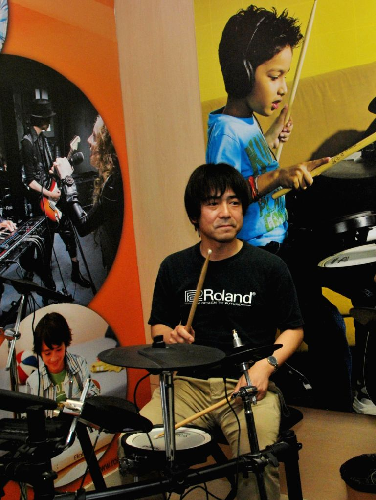 Shigeru Kimoto, Marketing Manager Roland Corporation , Japan perform during launch of India`s first Roland School of Music Japan in Kolkata on March 21, 2013.