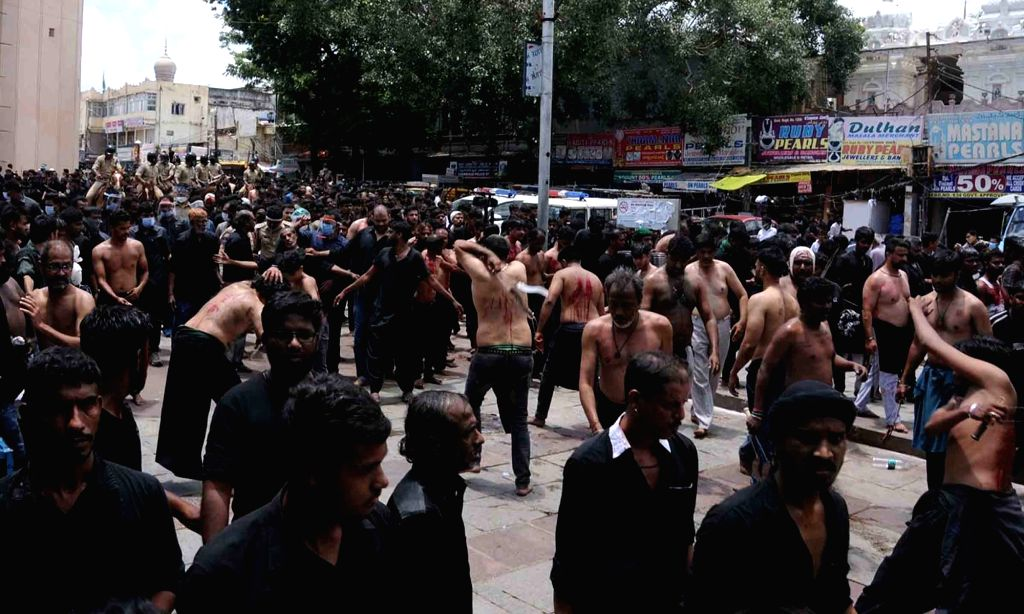 Shiite Muslims flagellate themselves during a procession organised to mark Ashura, the ninth day of Muharram (the first month of the Islamic calendar) to commemorate the martyrdom of Imam ...