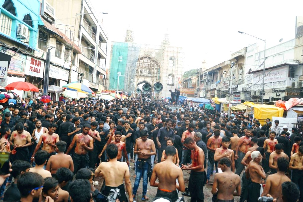 Shiites flagellate themselves as they observe the martyrdom day of Hazrat Ali, in Hyderabad on June 5, 2018.