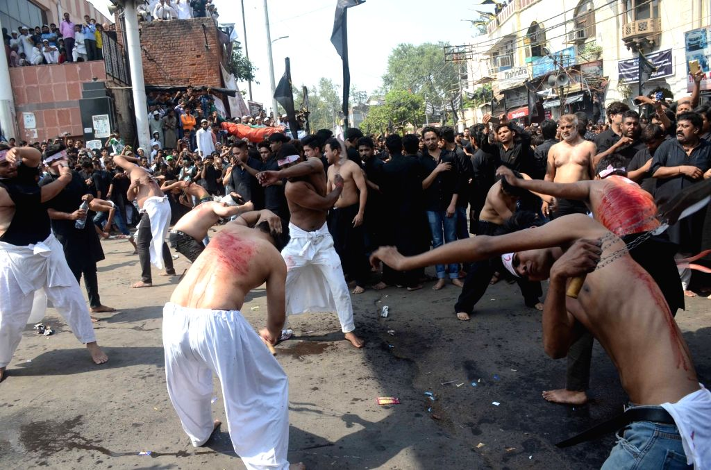 Shiites flagellate themselves during Muharram in New Delhi on Oct 12, 2016.