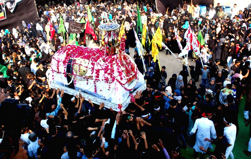 Shiites participate in the '72 Taboot' procession during the ongoing Muslim month of Muharram in Allahabad on Nov 2, 2018.