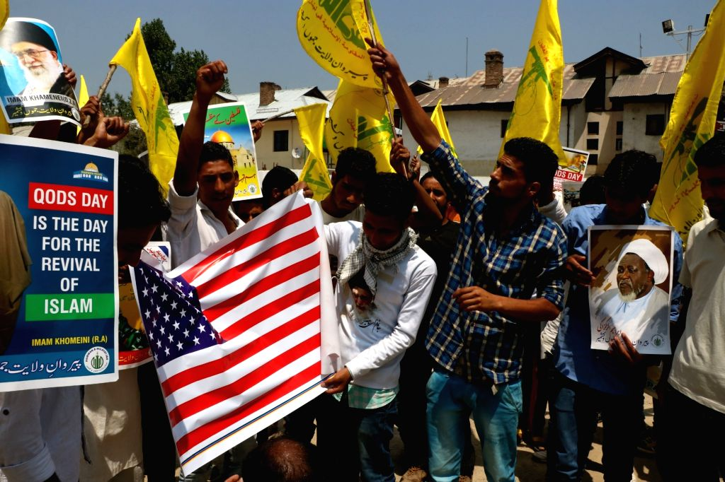 Shiites stage a demonstration against US and Israel on Quds Day in Srinagar on July 1, 2016.