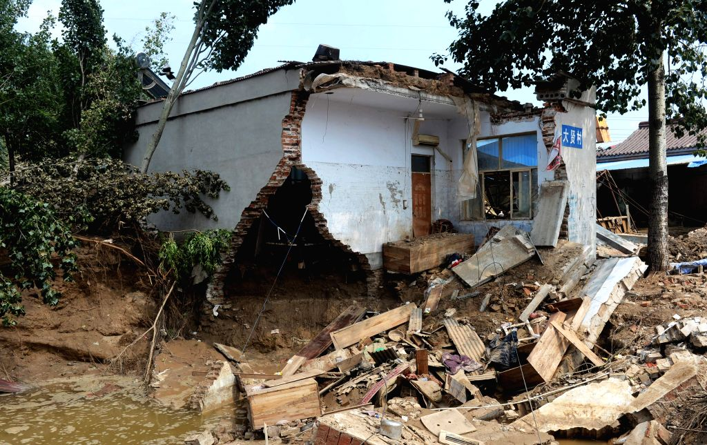 SHIJIAZHUANG, July 24, 2016 - Photo taken on July 24, 2016  shows a house destroyed in floods in Daxian Village of Xingtai City, north China's Hebei Province. Torrential rain and floods have left 130 ...