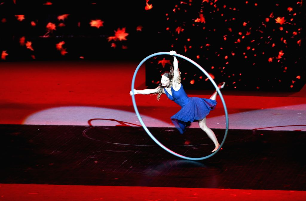 SHIJIAZHUANG, Oct. 26, 2019 - An acrobat performs during the opening performance of the 17th China Wuqiao International Circus Festival at Hebei provincial arts center in Shijiazhuang, capital of ...