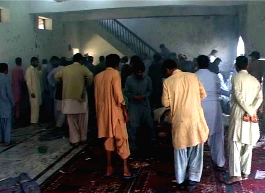 Local people gather inside a mosque at the blast site in southern Pakistan's Shikarpur on Jan. 30, 2015. At least 35 people were killed and over 50 others injured