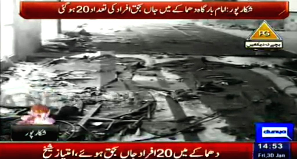 This TV grab on Jan. 30, 2015 from Dunya News Channel shows the blast site in southern Pakistan's Shikarpur. At least 20 people were killed and over 40 others ...