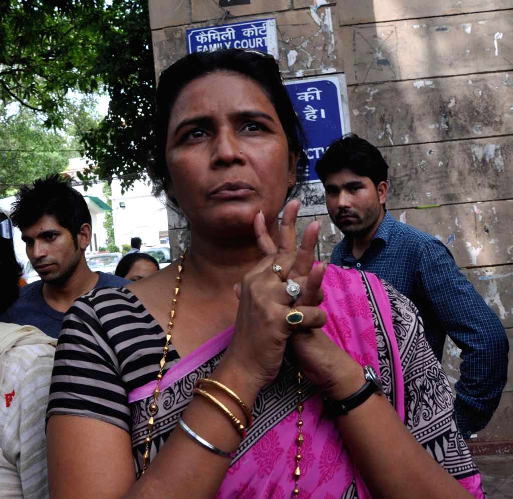 Shikha Singh, the sister of Sher Singh Rana, the lone convict in the murder of bandit-turned-politician Phoolan Devi talks to media after a Delhi court awarded life imprisonment to Rana, in New Delhi - Shikha Singh