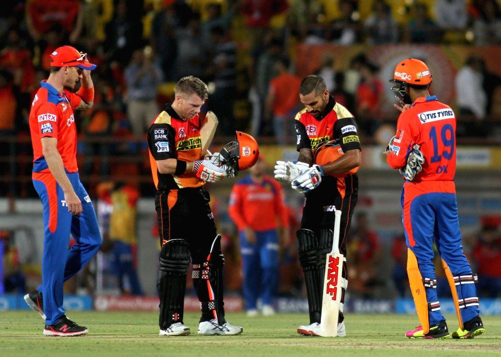 Shikhar Dhawan and David Warner of Sunrisers Hyderabad after winning the IPL match between Gujarat Lions and Sunrisers Hyderabad at Saurashtra Cricket Association Stadium in Rajkot on April ... - Shikhar Dhawan