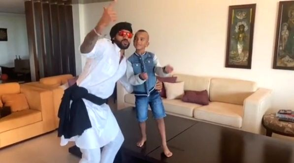 Shikhar Dhawan dances with son Zoravar on 'Daddy cool'. - Shikhar Dhawan