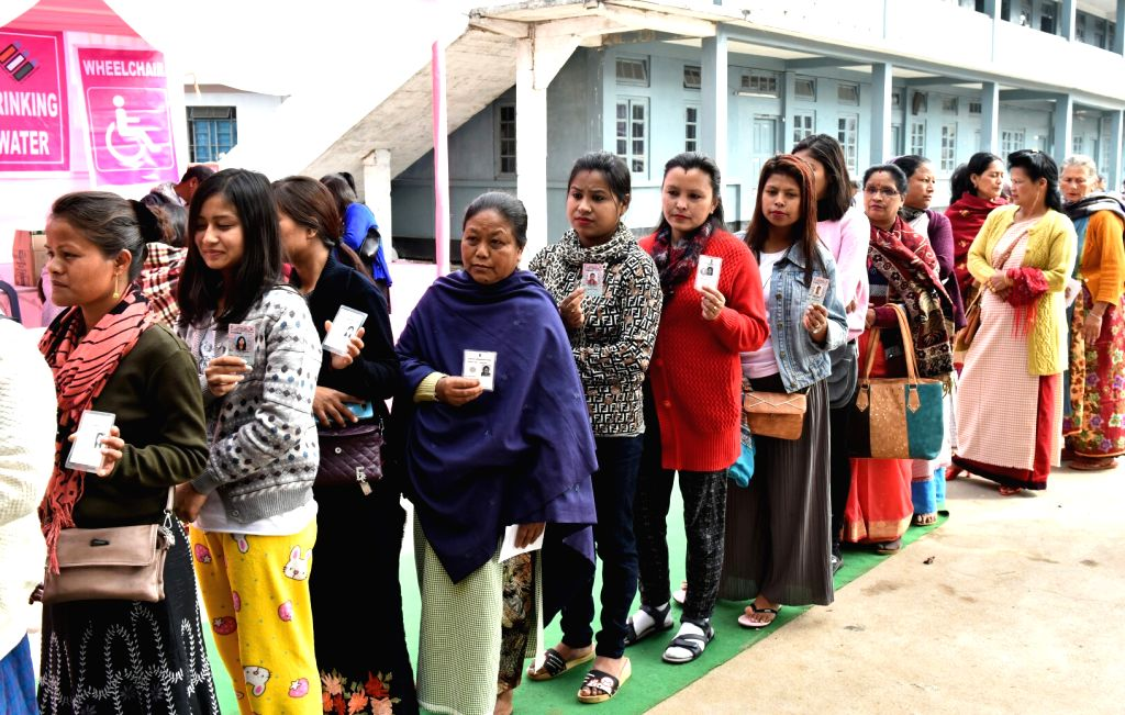 Shillong: Voters wait in a queue to cast their votes during Meghalaya Assembly elections in Shillong on Feb 27, 2018. A total of 18,09,818 electorates, including 9,13,702 women and 89,405 first-time voters are eligible to exercise their franchise to