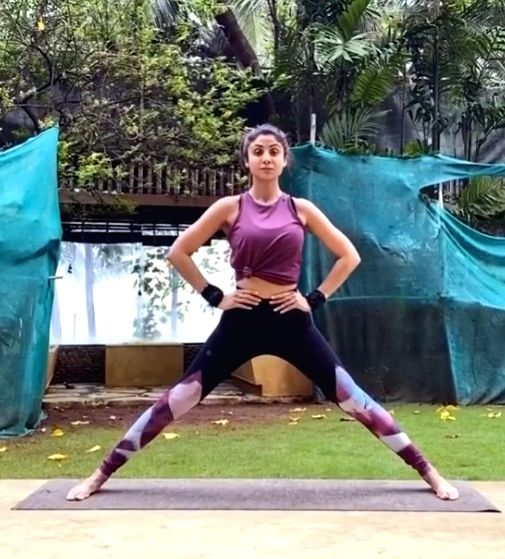 Shilpa - Shetty Best way to start my day and week is with yoga .