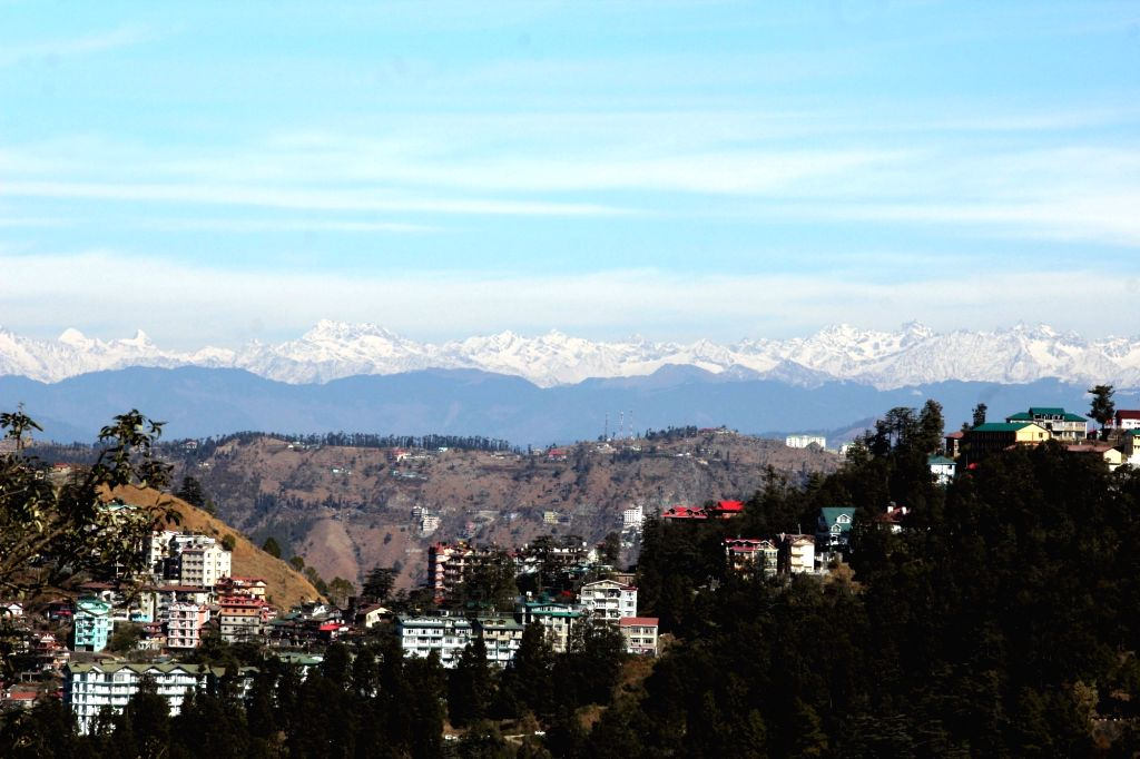 Shimla:A view of snow covered mountains seen from Shimla on Jan 3, 2019. (Photo: IANS)