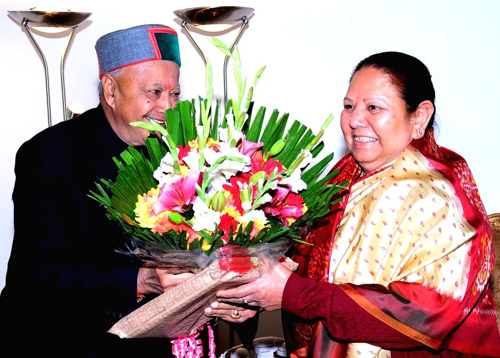 Himachal Chief Minister Virbharda Singh calls on the Governor of the state Urmila Singh at Raj Bhavan to greet her on new year in Shimla on Jan 1, 2015. - Virbharda Singh