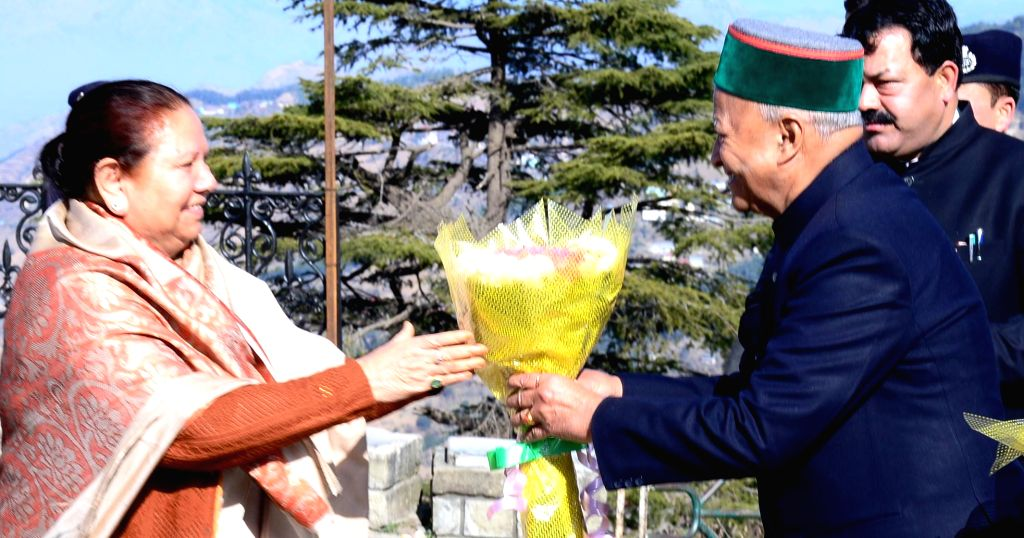 Himachal Pradesh Chief Minister Virbhadra Singh greets Governor Urmila Singh as she arrive to attend the Republic Day function in Shimla on Jan 26, 2015. - Virbhadra Singh and Urmila Singh