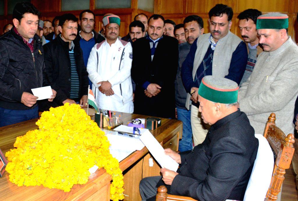 Himachal Pradesh Chief Minister Virbhadra Singh listens to public grievances in Shimla on Feb 24, 2015. - Virbhadra Singh