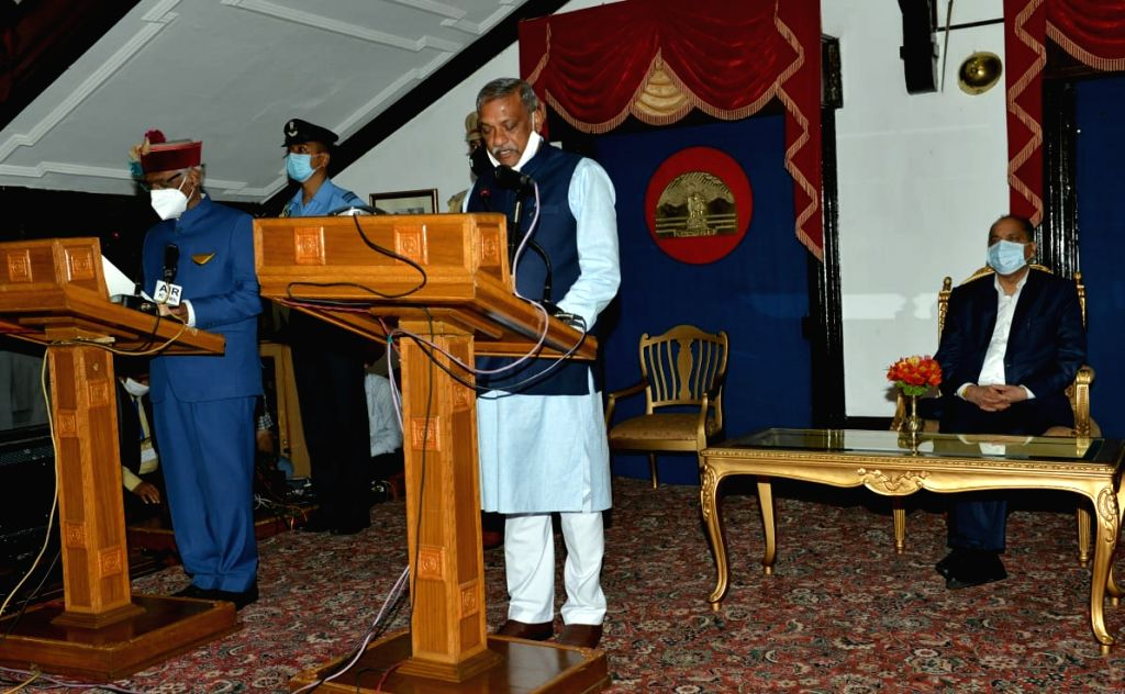 Shimla : Himachal Pradesh Governor Bandaru Dattatraya administered the oath of office and secrecy to three ministers - Sukh Ram Chaudhary MLA from Paonta Sahib Assembly constituency, Rakesh Pathania ... - Jai Ram Thakur