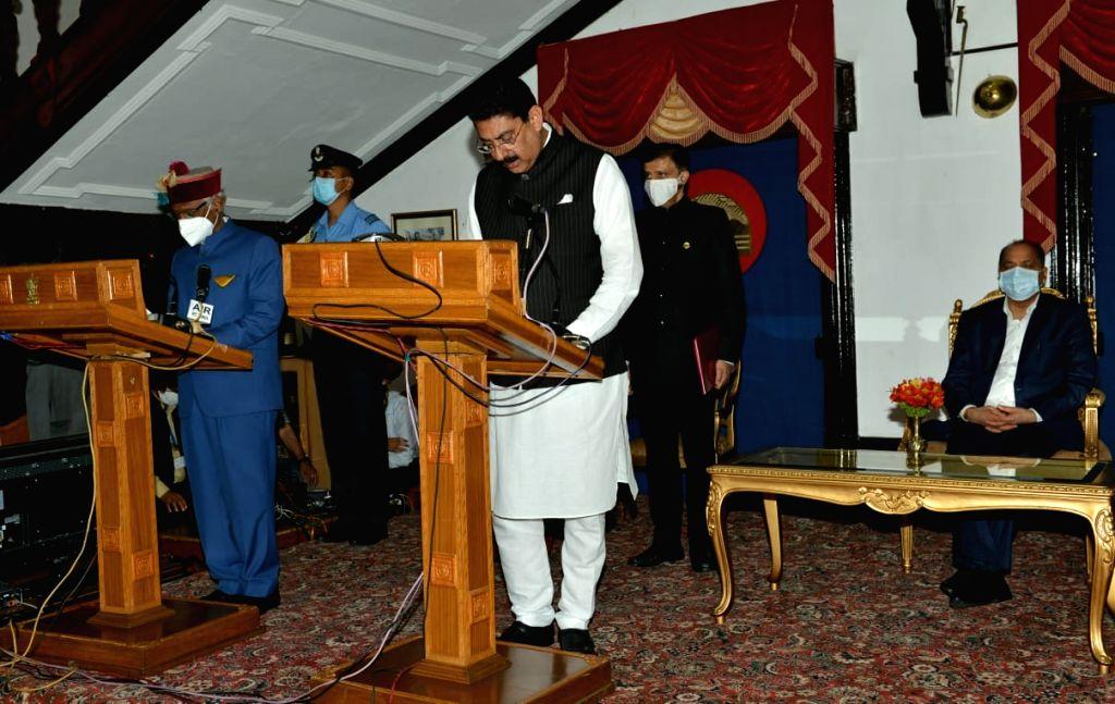 Shimla : Himachal Pradesh Governor Bandaru Dattatraya administered the oath of office and secrecy to three ministers - Sukh Ram Chaudhary MLA from Paonta Sahib Assembly constituency, Rakesh Pathania from Nurpur and Rajinder Garg of Ghumarwin constitu - Jai Ram Thakur