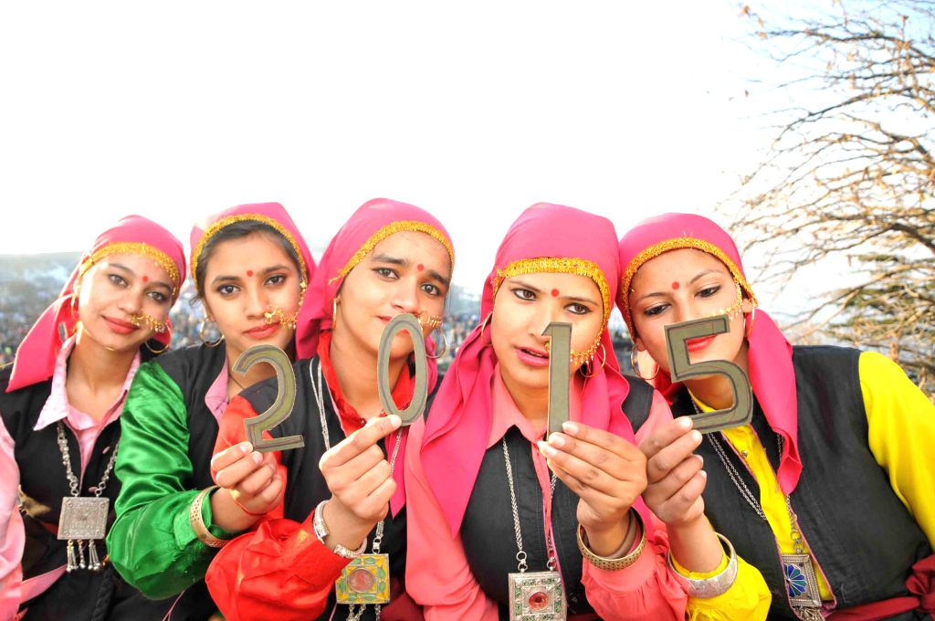 Himachali girls in their traditional attire welcome 2015 in Shimla, on Dec 31, 2014.