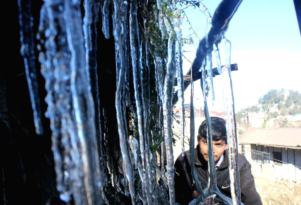 Shimla: Icicles hang from the roof of a house as temperature dips in Shimla on Dec 25, 2018. (Photo: IANS)