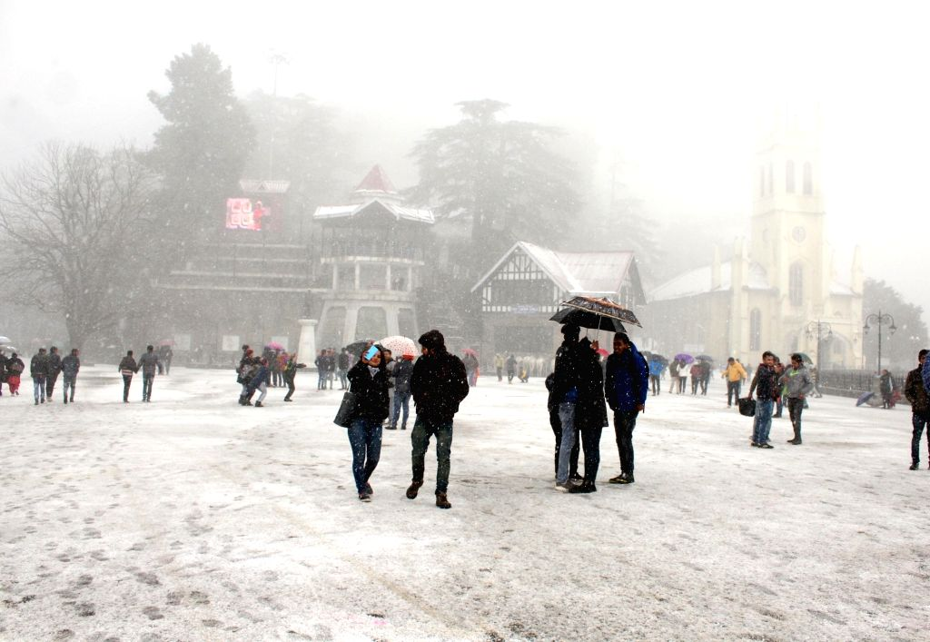: Shimla: People enjoy themselves during snowfalls in Shimla, on March 11, 2017. (Photo: IANS).