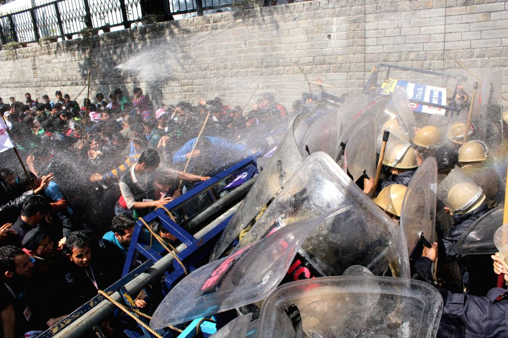Police charge water cannons on the SFI activists demonstrating against hike in fees of Himachal Pradesh University in Shimla, on March 18, 2015.