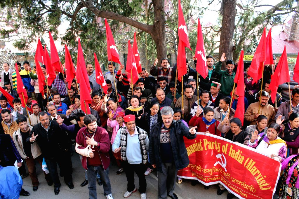 Shimla Mayor Sanjay Chauhan (Black Jacket) and Deputy Mayor Tikender Singh Panwar (Red Jacket) stage a demonstration against lathicharge and raid at CPI (M)`s party office in Shimla on March ...