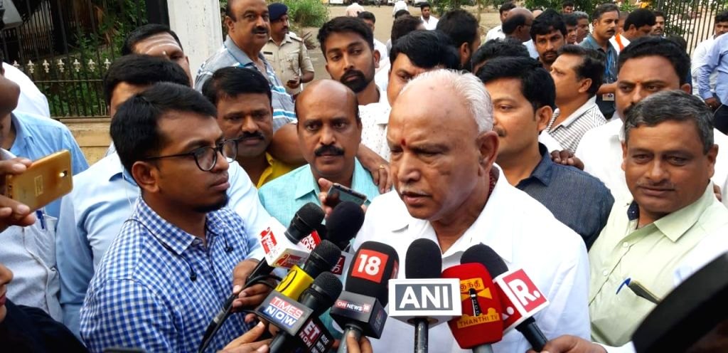 Shimoga: BJP leader B. S. Yeddyurappa talks to the media persons after casting his vote for the third phase of 2019 Lok Sabha elections, in Karnataka's Shimoga, on April 23, 2019. (Photo: IANS)